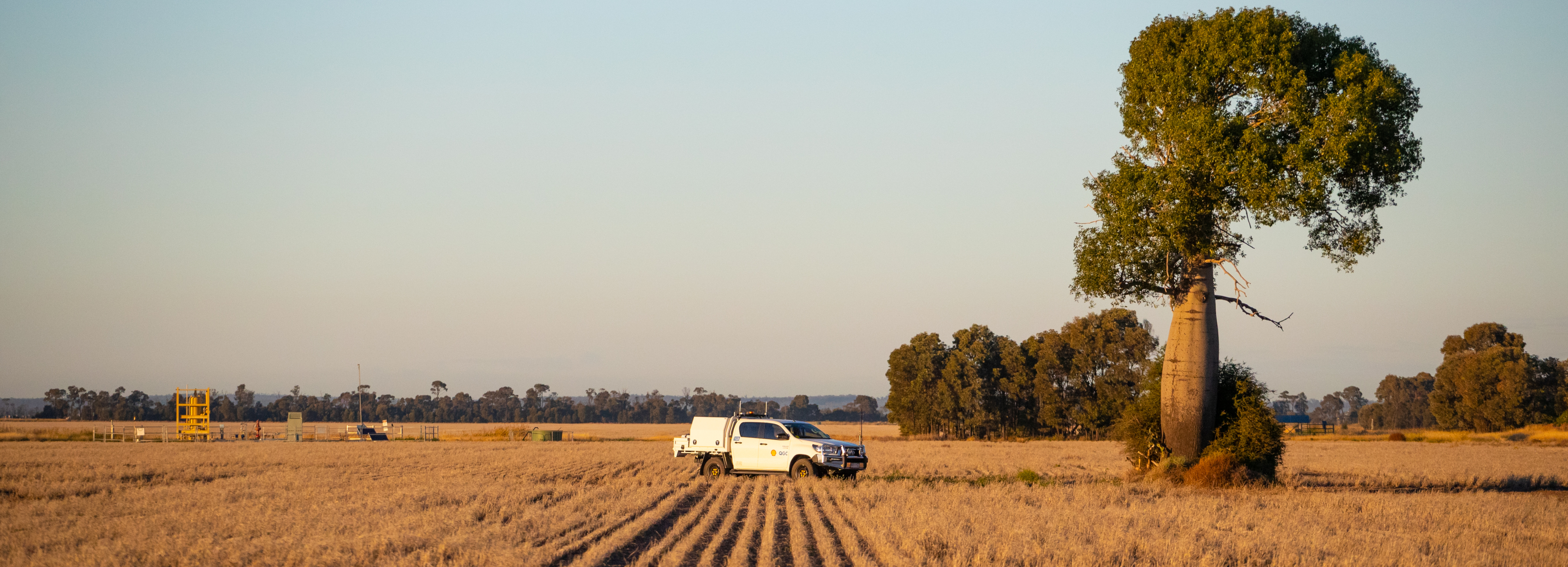 Wellsite on landholer property with vehicle and boab tree_cropped